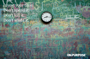 "Image of clock on wall. ""Invest your time. Don't spend it. Don't kill it. Don't waste it."""